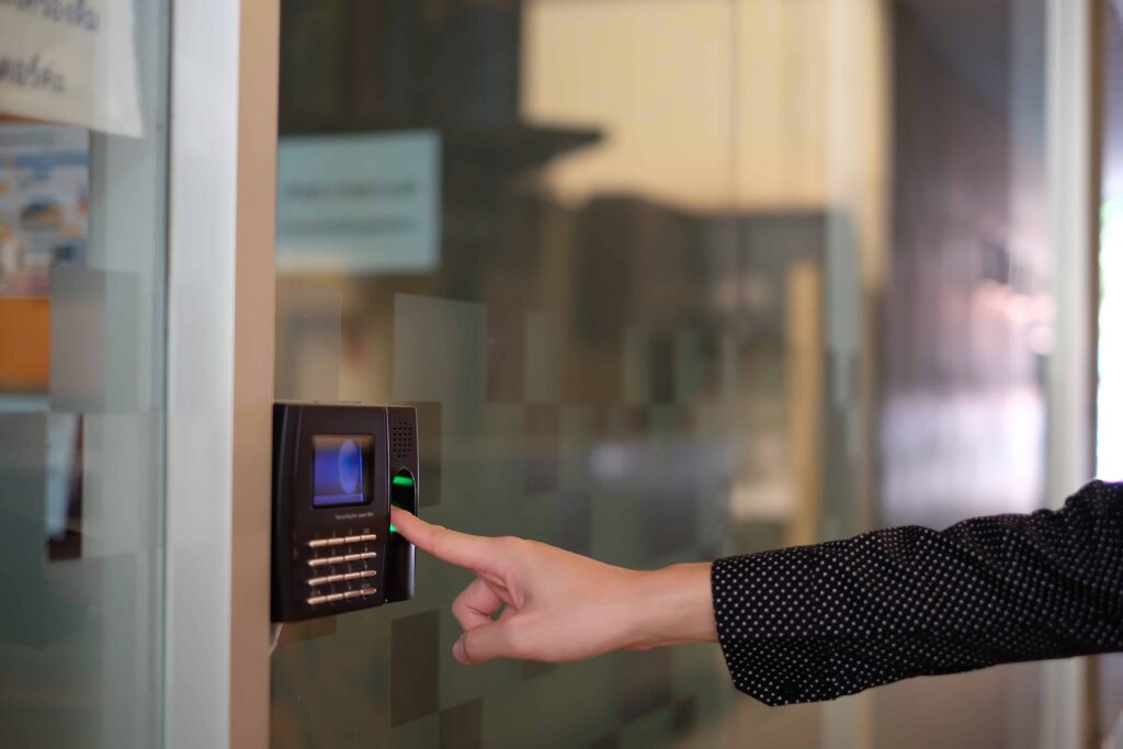 Employee using biometric clocking in terminal