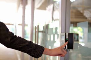 Employee Using a biometric clocking in machine